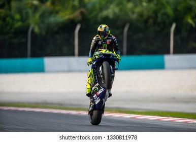SEPANG, MALAYSIA - FEBRUARY 06, 2019 : Valentino Rossi of Italy and Yamaha Factory Racing wheelie during the MotoGP Tests (Winter Test) at Sepang International Circuit (SIC).