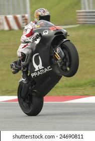 SEPANG, MALAYSIA -  FEBRUARY 7: Niccolo Canepa of Pramac Racing does a wheelie at MotoGP Official Test at Sepang, Malaysia on February 7, 2009.