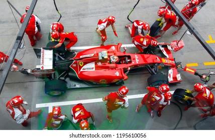 SEPANG, MALAYSIA : Ferrari Team driver, Kimi Raikkonen, entering crews does pit-stop practice at the 2014, F1 Petronas Malaysian Grand Prix at Sepang International Circuit on March 30, 2014