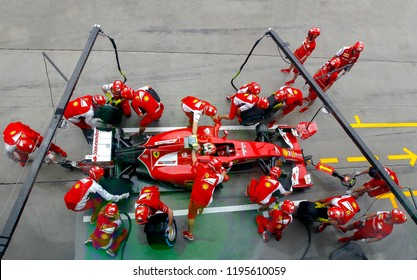 SEPANG, MALAYSIA : Ferrari Team driver, Kimi Raikkonen, entering crews does pit-stop practice at the 2014, F1 Petronas Malaysian Grand Prix at Sepang International Circuit on March 30, 2014