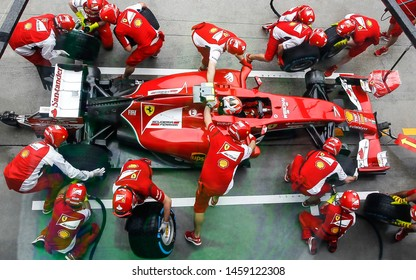 SEPANG, MALAYSIA : Ferrari Team driver, Kimi Raikkonen, entering crews does pit-stop practice at the 2014, F1 Petronas Malaysian Grand Prix at Sepang International Circuit on March 29, 2014