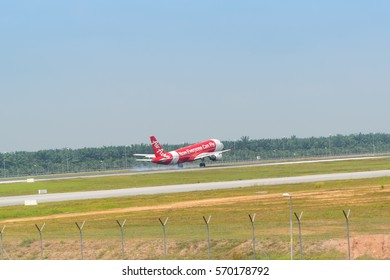 SEPANG, MALAYSIA - JANUARY 30, 2017: Air Asia plane Airbus A320-216, aircraft approaches runway for a landing at KLIA airport on January 30, 2017 in KLIA, Sepang, Malaysia.
