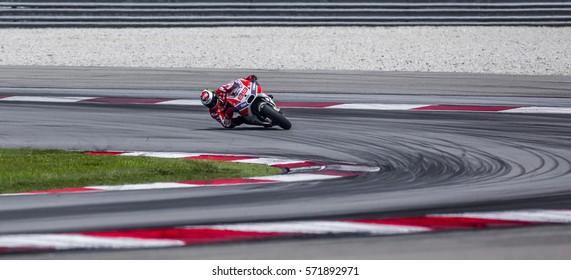SEPANG, MALAYSIA - JANUARY 30, 2017 : Ducati Team rider, Jorge Lorenzo taking a corner during 2017 MotoGP pre-season test (Winter Test) at the Sepang International Circuit.