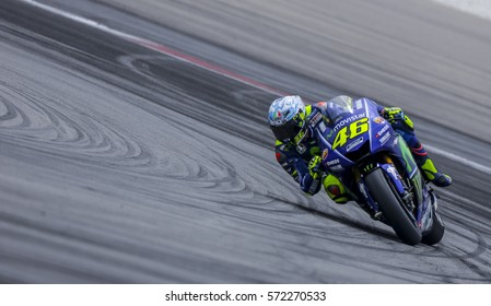 SEPANG, MALAYSIA - JANUARY 30, 2017 : Movistar Yamaha MotoGP rider, Valentino Rossi taking a corner during 2017 MotoGP pre-season test (Winter Test) at the Sepang International Circuit.
