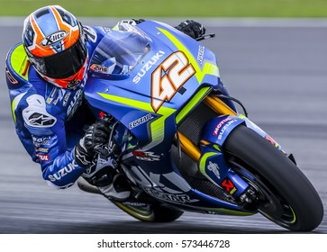 SEPANG, MALAYSIA - JANUARY 30, 2017 : Team SUZUKI ECSTAR rider, Alex Rins taking a corner during 2017 MotoGP pre-season test at the Sepang International Circuit.