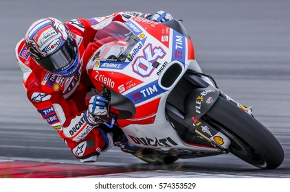 SEPANG, MALAYSIA - JANUARY 30, 2017 : Ducati Team rider, Andrea Dovizioso taking a corner during 2017 MotoGP pre-season test at the Sepang International Circuit.