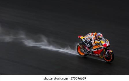 SEPANG, MALAYSIA - JANUARY 30, 2017 : Repsol Honda Team rider, Dani Pedrosa powers his bike on the wet track during 2017 MotoGP pre-season test at the Sepang International Circuit.