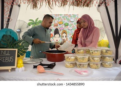 Sepang, Malaysia - July 27, 2019 : Volunteer workers preparing traditional Noodle soup called Mee Rebus in malay language for Eid Mubarak open house celebrations.