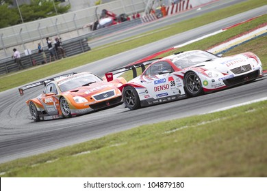 SEPANG, MALAYSIA - JUNE 10: Team Sard in their Lexus enters turn 2at Super GT Race June 10, 2012 in Sepang, Malaysia