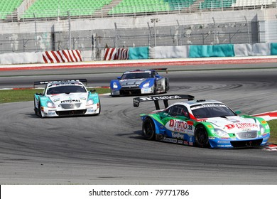 SEPANG, MALAYSIA - JUNE 19: The Lexus Team Kraft's car (35) is ahead of the Petronas Tom's car (36) in the early laps of the Japan SUPER GT Round 3 GT 500 race on June 19, 2011 in Sepang, Malaysia.