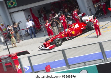 SEPANG, MALAYSIA - MARCH 23: Spanish Fernando Alonso of Team Scuderia Ferrari exits his pit for Friday practice at Petronas Formula 1 Grand Prix March 23, 2012 in Sepang, Malaysia