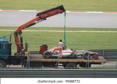 SEPANG, MALAYSIA - MARCH 23: A Team HRT F1 car towed back to the pits after an accident during Friday practice at Petronas Formula 1 Grand Prix March 23, 2012 in Sepang, Malaysia