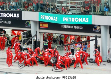 SEPANG, MALAYSIA - MARCH 25: Ferrari F1 Team crews does pit-stop practice at the 2012 F1 Petronas Malaysian Grand Prix at Sepang International Circuit on March 25, 2012 in Sepang, Malaysia