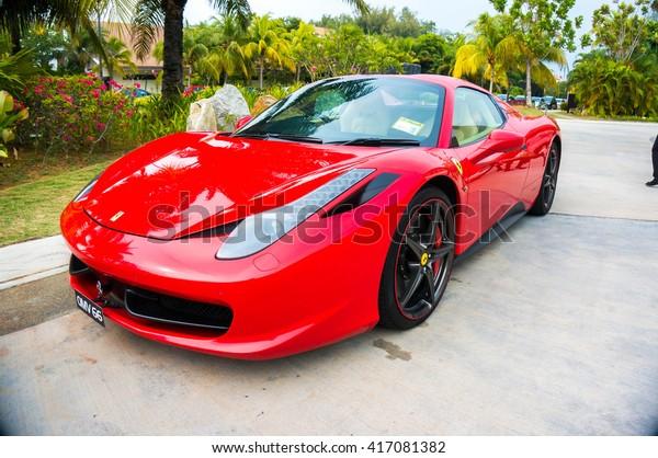 SEPANG, MALAYSIA - MAY 8, 2016: Ferrari 458 Italia parking on the side road. Photo at AVANI Sepang Goldcoast, Bagan Lalang road.