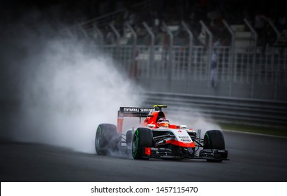SEPANG, MALAYSIA : Motion blur. Grain. Noise. Soft. Marussia F1 Team driver, Jules Bianchi, during the F1 Petronas Malaysia Grand Prix at Sepang International Circuit on March 30, 2014
