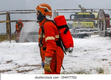 SEPANG, MALAYSIA - NOV 26, 2014: Malaysian rescue personnel works at a mock scene of an airplane crash-site during an emergency drill at Kuala Lumpur International Airport (KLIA) in Sepang, Malaysia.
