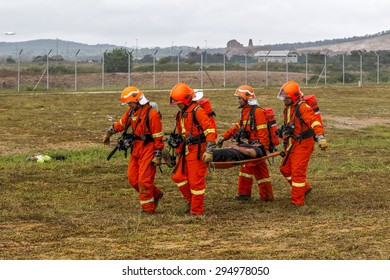 SEPANG, MALAYSIA - NOV 26, 2014: Malaysian rescuers at a mock scene of an airplane crash-site during an emergency drill at Kuala Lumpur International Airport (KLIA) in Sepang, Malaysia.