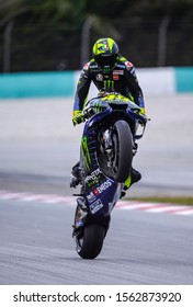 SEPANG, MALAYSIA - NOVEMBER 01, 2019 : Valentino Rossi of Italy and Monster Energy Yamaha wheelie during free practice of the Malaysia Motorcycle Grand Prix (MotoGP) at Sepang International Circuit.