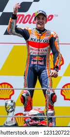 SEPANG, MALAYSIA - NOVEMBER 04, 2018 : Marc Marquez of Spain and Repsol Honda Team celebrates the victory on the podium at the end of the Malaysian Motorcycle Grand Prix (MotoGP) at Sepang Circuit.
