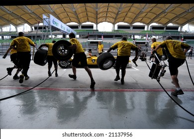 Sepang, Malaysia - November 21: Malaysian Team Pit Crew, Practice changing the tyre in the Malaysian A1Grand Prix,  Round 3 2008-2009 Session.