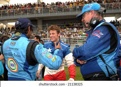 Sepang, Malaysia - November 23: Narain Karthikeyan shake hand with Marco Andretti. Previously they meet are involved in terrible accident in the Malaysian A1Grand Prix,  Round 3, 2008-2009 Session.