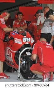 SEPANG, MALAYSIA - OCT 23 : Mechanics prepare American Nicky Hayden's bike of Ducati Marlboro Team at Shell Advance Malaysian Motorcycle Grand Prix held October 23, 2009 in Sepang, Malaysia.