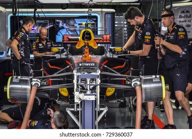 SEPANG, MALAYSIA : OCTOBER 01, 2017 : Mechanics of Max Verstappen Red Bull Racing in the garage during the Malaysia Formula One (F1) Grand Prix at Sepang International Circuit (SIC).