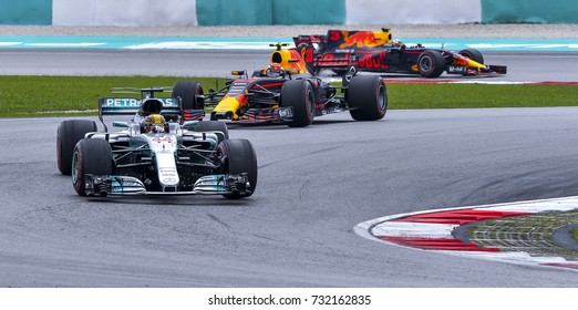 SEPANG, MALAYSIA : OCTOBER 01, 2017 : Lewis Hamilton (44) of Mercedes leads Max Verstappen (33) of Red Bull Racing during the Malaysia Formula One (F1) Grand Prix at Sepang International Circuit.