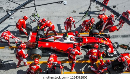 SEPANG, MALAYSIA - OCTOBER 02, 2016 : Team members of Kimi Raikkonen of Scuderia Ferrari change tyre at pit stop during the Malaysia Formula One (F1) Grand Prix at Sepang International Circuit (SIC).