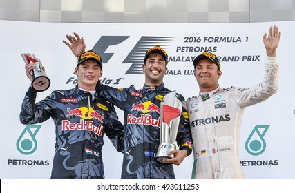 SEPANG, MALAYSIA - OCTOBER 02, 2016 : Red Bull Racing driver, Daniel Ricciardo (c) with Max Verstappen (l) and Nico Rosberg (r) the podium Formula One (F1) Petronas Malaysia Grand Prix 2016.