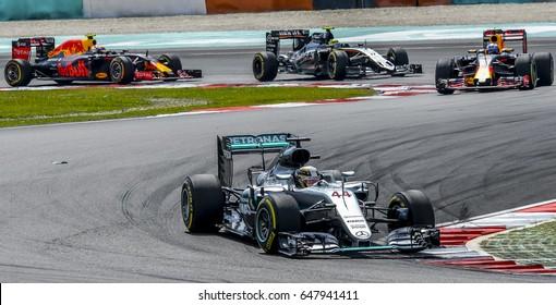 SEPANG, MALAYSIA - OCTOBER 02, 2016 : Mercedes AMG Petronas Formula One Team driver, Lewis Hamilton (front) during 2016 Formula 1 Petronas Malaysia Grand Prix.