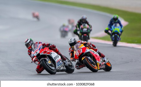 SEPANG, MALAYSIA - OCTOBER 27, 2017 : Jorge Lorenzo of Spain and Ducati (99) with Marc Marquez of Repsol Honda during the Malaysia Motorcycle Grand Prix (MotoGP) at Sepang International Circuit (SIC).