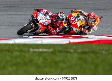 SEPANG, MALAYSIA - OCTOBER 28, 2017 : Jorge Lorenzo of Ducati Team (99) & Marc Marquez of Repsol Honda Team (93) during the Malaysia Motorcycle Grand Prix (MotoGP) at Sepang International Circuit.