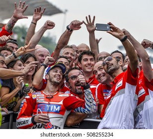 SEPANG, MALAYSIA - OCTOBER 30, 2016 :  Ducati Team rider, Andrea Dovizioso celebrates with team crew after winning the Shell Malaysia Motorcycle Grand Prix (GP) 2016.