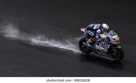 SEPANG, MALAYSIA - OCTOBER 30, 2016 : Avintia Racing rider, Loris Baz powers his bike on the wet track during Shell Malaysia Motorcycle Grand Prix (GP) 2016.