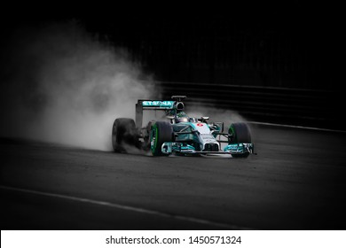 SEPANG, MALAYSIA : Selective focus. Motion bur. Mercedes AMG Petronas F1, Nico Rosberg, during the F1 Petronas Malaysia Grand Prix at Sepang International Circuit on March 30, 2014
