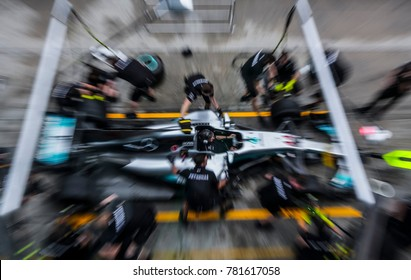 SEPANG, MALAYSIA - SEPTEMBER 28, 2017 : Team members of Mercedes British driver Lewis Hamilton practice a pit stop ahead of the Malaysia Formula One (F1) Grand Prix at Sepang International Circuit.