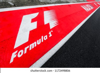 SEPANG, MALAYSIA : SEPTEMBER 29, 2017 : Formula One (F1) logo on asphalt red and white of a race track. Motorsports racing circuit close up.