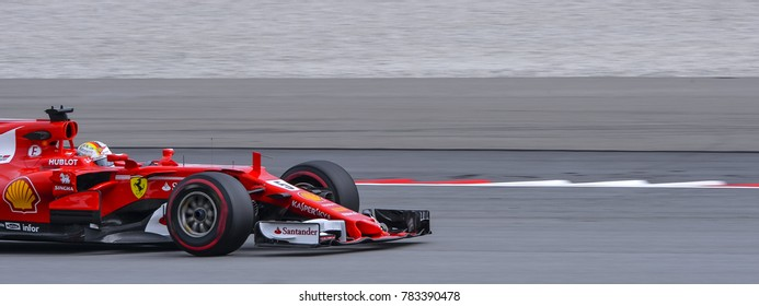 SEPANG, MALAYSIA - SEPTEMBER 29, 2017 : Sebastian Vettel of Germany driving the (5) Scuderia Ferrari on track during the Malaysia Formula One (F1) Grand Prix at Sepang International Circuit (SIC).