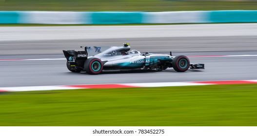 SEPANG, MALAYSIA - SEPTEMBER 29, 2017 : Valtteri Bottas of Finland driving the (77) Mercedes AMG Petronas on track during the Malaysia Formula One (F1) Grand Prix at Sepang International Circuit.