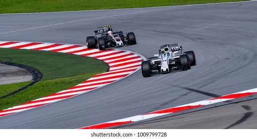 SEPANG, MALAYSIA - SEPTEMBER 30, 2017 : Felipe Massa of Brazil driving the (19) Williams Martini Racing on track during the Malaysia Formula One (F1) Grand Prix at Sepang International Circuit.