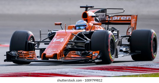 SEPANG, MALAYSIA - SEPTEMBER 30, 2017 : Fernando Alonso of Spain driving the (14) McLaren Honda Formula 1 Team on track during the Malaysia Formula One (F1) Grand Prix at Sepang International Circuit.