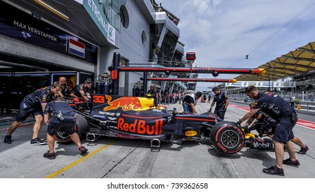 SEPANG, MALAYSIA : SEPTEMBER 30, 2017 : The Red Bull Racing team work on the car of Max Verstappen in the Pitlane during the Malaysia Formula One (F1) Grand Prix at Sepang International Circuit (SIC).
