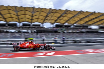 SEPANG, MALAYSIA : SEPTEMBER 30, 2017 : Kimi Raikkonen of Scuderia Ferrari drives in pit lane during the practice session of the Malaysia Formula One (F1) Grand Prix at Sepang International Circuit.