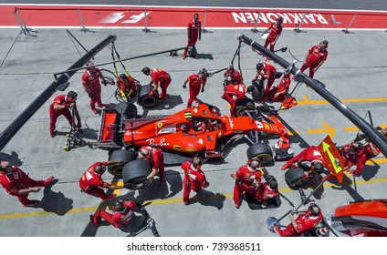 SEPANG, MALAYSIA : SEPTEMBER 30, 2017 : Team members of Kimi Raikkonen of Scuderia Ferrari practice a pit stop ahead of the Malaysia Formula One (F1) Grand Prix at Sepang International Circuit (SIC).