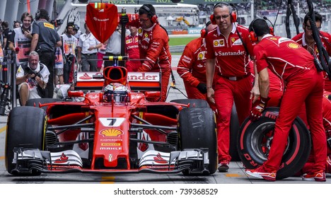 SEPANG, MALAYSIA : SEPTEMBER 30, 2017 : The Scuderia Ferrari team work on the car of Kimi Raikkonen in the Pitlane during the Malaysia Formula One (F1) Grand Prix at Sepang International Circuit.