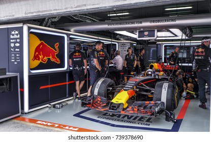 SEPANG, MALAYSIA : SEPTEMBER 30, 2017 : The Red Bull Racing team work on the car of Daniel Ricciardo in the garage during the Malaysia Formula One (F1) Grand Prix at Sepang International Circuit.