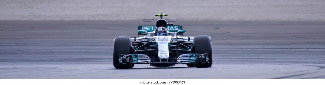 SEPANG, MALAYSIA - SEPTEMBER 30, 2017 : Valtteri Bottas of Finland driving the (77) Mercedes AMG Petronas on track during the Malaysia Formula One (F1) Grand Prix at Sepang International Circuit.
