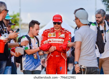 SEPANG, MALAYSIA - SEPTEMBER 30, 2017 : Kimi Raikkonen of Finland and Scuderia Ferrari with fans during the Malaysia Formula One (F1) Grand Prix at Sepang International Circuit (SIC).