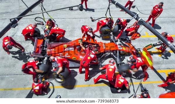 SEPANG, MALAYSIA : SEPTEMBER 30, 2017 : Team members of Kimi Raikkonen of Scuderia Ferrari practice a pit stop ahead of the Malaysia Formula One (F1) Grand Prix at Sepang International Circuit (SIC).